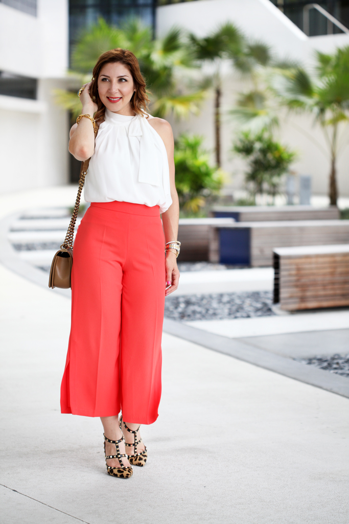 Blame-it-on-Mei-Miami-Fashion-Blogger-2016-Summer-Outfit-Orange-Culottes-Bow-Top-Chanel-Boy-Leopard-Heels-Soft-Waves-Short-Hair