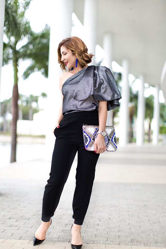 Blame-it-on-Mei-Miami-Fashion-Blogger-2016-Holiday-Outfit-NYE-Look-Metallic-Asymetric-Top-with-Ruffle-Joggers-Patent-Iriza-Louboutin-Beaded-Clutch-Tassel-Earrings-Curls-Short-Hair